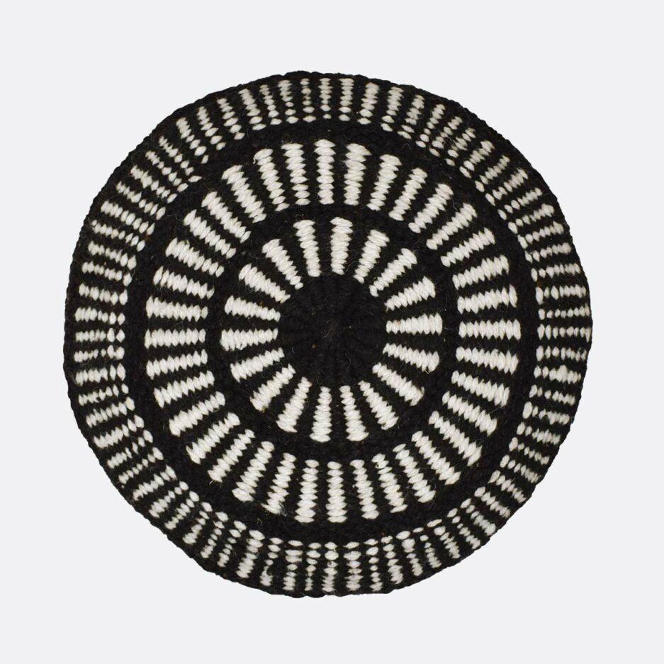 Coussin ethnique rond motif noir Finca Home